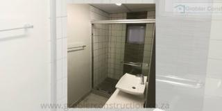 Staff Shower — in Strand, Western Cape.