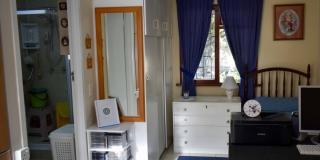 Serenitas Bachelors Unit Lounge Back View