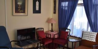 Serenitas Bachelors Unit Lounge Front Angle